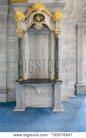 Arch frame niche embedded in a marble wall