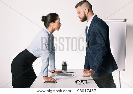 Serious Business People Having Disagreement And Looking At Each Other In Office