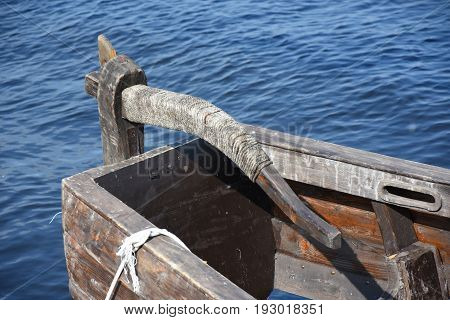 Wooden rudder near the ancient Russian ship - rooks
