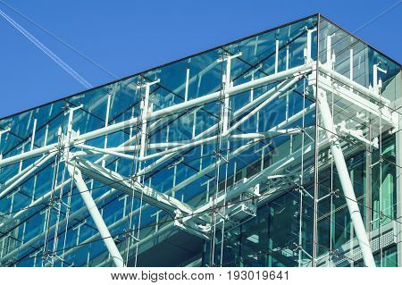 blue building all glass square patern on white sky background.
