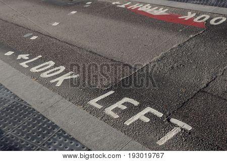 Look Left warning at a pedestrian zebra crossing in a London street.