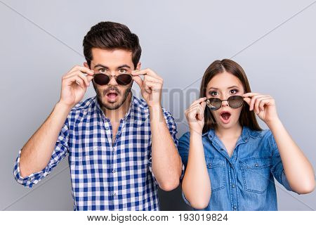 Oh Really?! Wow! Two Young Shocked Lovers Are Amazed With Wide Open Eyes, Mouthes, Touching Sun Glas