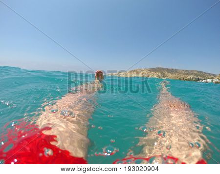 Legs Of A Swimmer In Red Swimwear Floating In The Sea