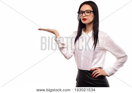 Beauty fashion sexy girl wearing glasses showing empty copy space on the open hand palm for text white background. Happy woman presenting point. Proposing product. Advertisement gesture