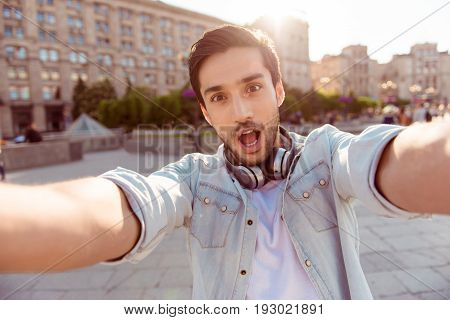 Selfie Time! Young Funky Blogger Is Making Photo For His Social Networks Page, He Is Posing In A Cas
