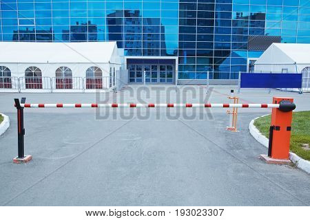 horizontal security barrier at the entrance to the car park