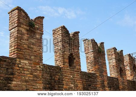 Detail of an old fortified wall of the medieval Castle .