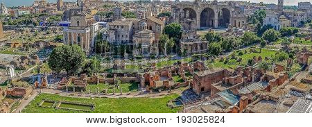 ROME ITALY - MAY 31 2017: Panoramic view over the ruins of the Roman Forum with the cityscape of Rome Italy.