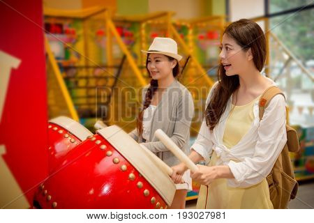 Female Tourists Experience The Drum Music Game