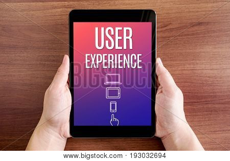 Two Hand Holding Tablet With User Experience And Icon On Screen At Dark Brown Table Top,digital Busi