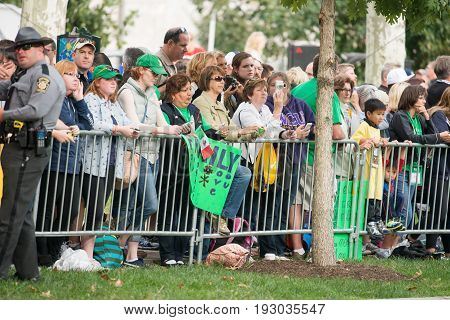 PHILADELPHIA, PA - SEPTEMBER 26: Crowds of people arrive on the Benjamin Franklin Parkway in Center City Philadelphia to see Pope Francis at the World Meeting of Families on September 26, 2015.