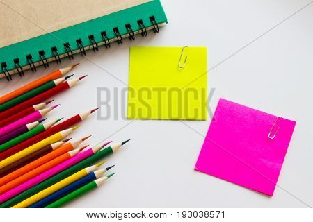 Post-it and colorful pencil background. It's tools for education.