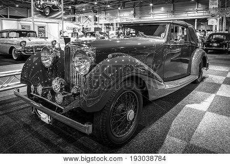 MAASTRICHT NETHERLANDS - JANUARY 14 2016: Vintage car Bentley 4 1/4 Litre Derby Drophead Coupe 1936. Black and white. International Exhibition InterClassics & Topmobiel 2016