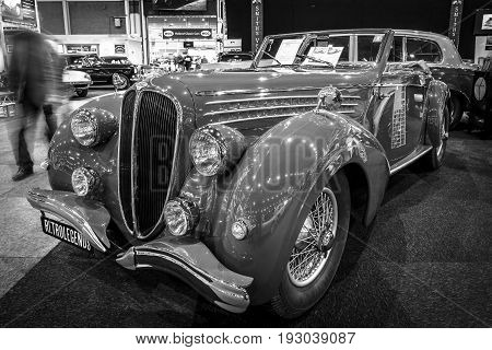 MAASTRICHT NETHERLANDS - JANUARY 14 2016: Luxury car Delahaye 135 MS Cabriolet by Pennock 1948. Black and white. International Exhibition InterClassics & Topmobiel 2016