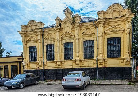The building of construction of the 19th century from a red brick. The building is painted in yellow color. Walls of the house have a set of elements of ornament. Armavir Krasnodar Krai Russia.