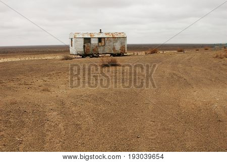 Abandoned dwelling in the desert. Aral Sea