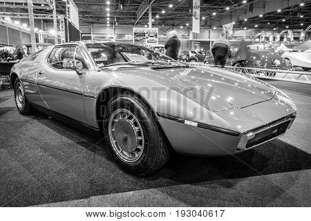 MAASTRICHT NETHERLANDS - JANUARY 15 2016: Mid-engined two-seat coupe Maserati Bora 1973. Black and white. International Exhibition InterClassics & Topmobiel 2016