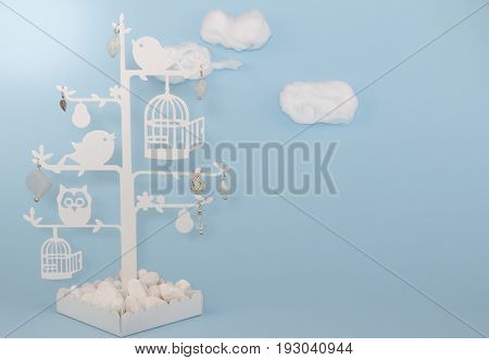 Baby boy blue background invitation with cottonwool clouds and bird trinket tree