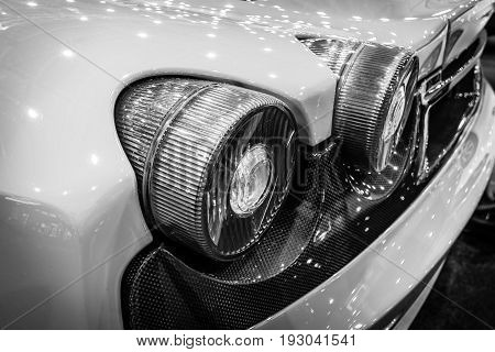 MAASTRICHT NETHERLANDS - JANUARY 15 2016: Stoplight of a sports car Ferrari F430 close-up 2006. Black and white. International Exhibition InterClassics & Topmobiel 2016