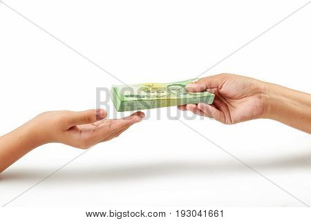 Closeup hands giving money on white background. Person hand giving money to other hand