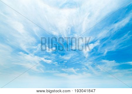 The vast blue sky with light clouds.