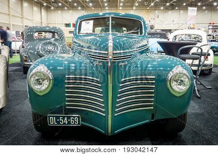 MAASTRICHT NETHERLANDS - JANUARY 15 2016: Full-size car Plymouth Deluxe (P10) Business Coupe 1941. International Exhibition InterClassics & Topmobiel 2016
