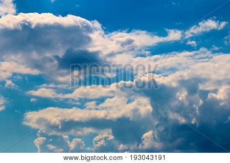 A heavenly landscape with sunny clouds and a transparent sky