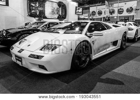 MAASTRICHT NETHERLANDS - JANUARY 15 2016: High-performance mid-engined sports car Lamborghini Diablo VT 6.0 2000. Black and white. International Exhibition InterClassics & Topmobiel 2016