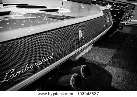 MAASTRICHT NETHERLANDS - JANUARY 15 2016: Fragment of a high-performance mid-engined sports car Lamborghini Diablo VT 6.0 2000. Black and white. International Exhibition InterClassics & Topmobiel 2016