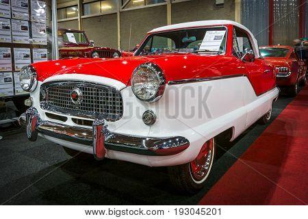 MAASTRICHT NETHERLANDS - JANUARY 15 2016: Subcompact car Nash Metropolitan 1960. International Exhibition InterClassics & Topmobiel 2016