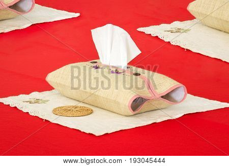 tissue box on the red table background