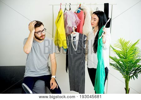 Woman has nothing to wear, her husband is bored