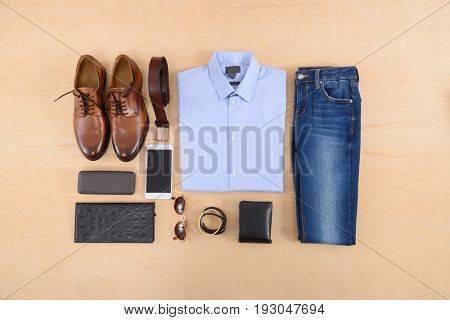 Men's casual outfits with man clothing,shoes on wooden background,