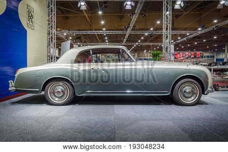 MAASTRICHT NETHERLANDS - JANUARY 15 2016: Luxury car Bentley S3 Continental Coupe by Mulliner & Park Ward 1964. International Exhibition InterClassics & Topmobiel 2016