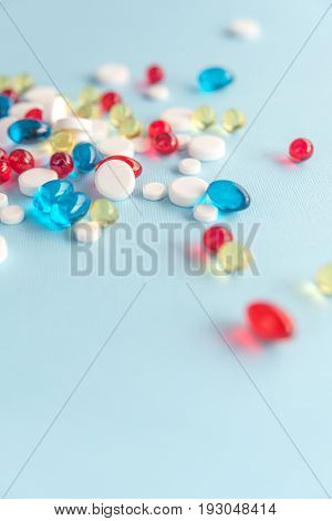 Colorful capsules spread all over isolated