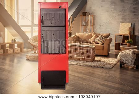 Energy savings concept. Solid fuel boiler in living room