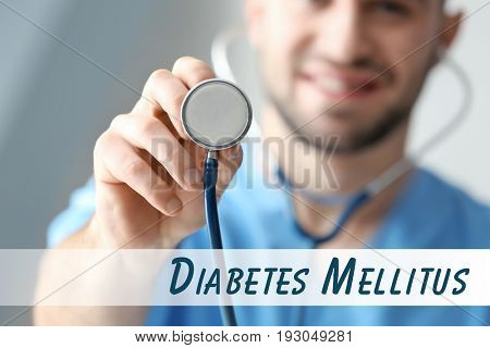 Health care concept. Doctor with stethoscope and text DIABETES MELLITUS, closeup