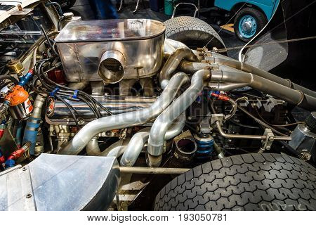 MAASTRICHT NETHERLANDS - JANUARY 15 2016: Engine of a high performance American-British endurance racing car Ford GT40 Mark IV 1967. Close-up. International Exhibition InterClassics & Topmobiel 2016