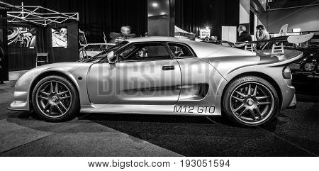 MAASTRICHT NETHERLANDS - JANUARY 15 2016: Sports car Noble M12 GTO 2000. Black and white. International Exhibition InterClassics & Topmobiel 2016