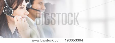 Side view of businesswoman working with headset at office