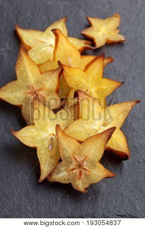 Sliced carambola, or starfruit, on a slate surface