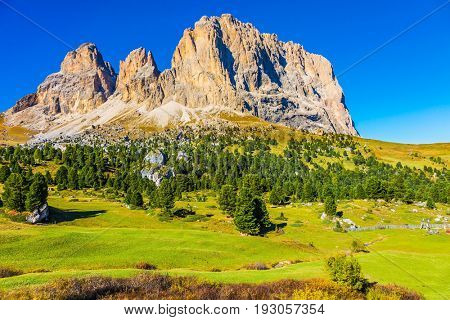 Travel to South Tirol. The picturesque Sella Pass in the Dolomites. Windy sunny day.  The concept of extreme and ecological tourism