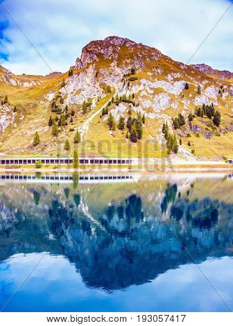 Mountain Lake Lago di Fedadia, Dolomites. Glacial lake with clear cold water. The concept of ecological and extreme tourism