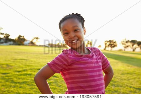 Portrait of African elementary school girl posing in a park