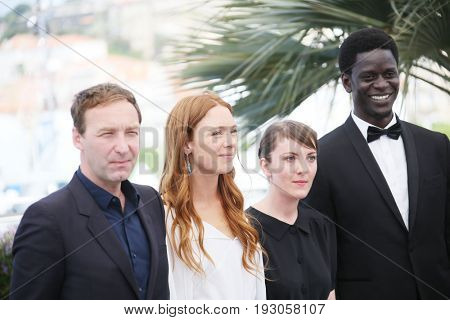 Gregoire Monsaingeon, Laetitia Dosch, Leonor Serraille, Souleymane Seye Ndiaye attend the 'Jeune Femme' photocall during the 70th Cannes Film Festival at Palais on May 23, 2017 in Cannes, France.