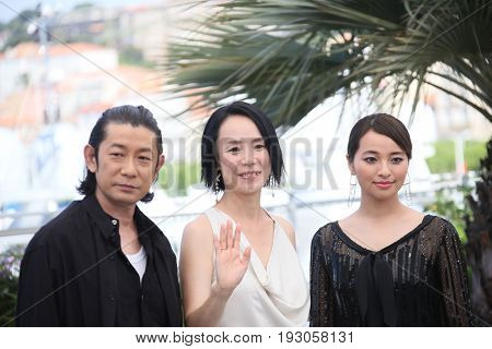 Nagase Masatoshi,  Naomi Kawase and Ayame Misaki attend the 'Hikari (Radiance)' photocall during the 70th annual Cannes Film Festival at Palais des Festivals on May 23, 2017 in Cannes, France.