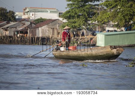 Can Tho, Vietnam - March 24, 2017 : Local people selling their good on Cai Rang Floating Market, most famous and biggest floating market in Mekong Delta with hundreds of boats packed.