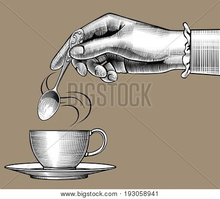 Woman's hand with a coffee cup and spoon. Vintage stylized drawing