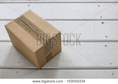 Cardboard delivery parcel box delivered to doorstep closeup poster