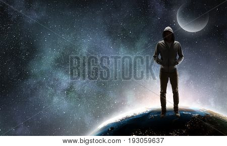 Silhouette of man in hoody